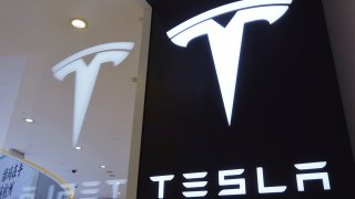 A Tesla logo is seen at a store on April 21, 2020, in Hangzhou, Zhejiang Province of China.