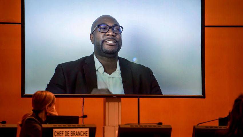 "A TV screen displays George Floyd's brother, Philonise Floyd speaking via video message during an urgent debate on ""systemic racism"" in the United States and beyond at the Human Rights Council on June 17, 2020 in Geneva."