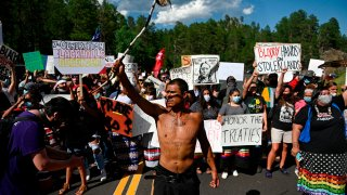 Activists and members of different tribes from the region block the road to Mount Rushmore National Monument