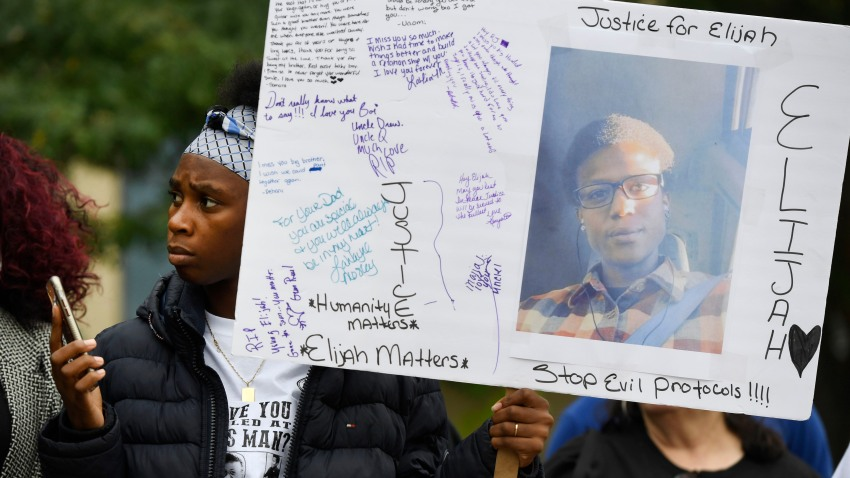 In this Oct. 1, 2019, file photo, Rashiaa Veal holds a sign featuring her cousin, Elijah McClain, at a news conference in front of the Aurora Municipal Center in Aurora, Colorado.