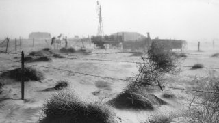 A dust bowl farmstead in Dallam County, Texas, showing the desolation produced by the dust and wind on the countryside.