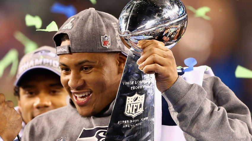 Outside linebacker and Super Bowl MVP Malcolm Smith #53 of the Seattle Seahawks holds the Vince Lombardi Trophy after winning Super Bowl XLVIII at MetLife Stadium on February 2, 2014 in East Rutherford, New Jersey