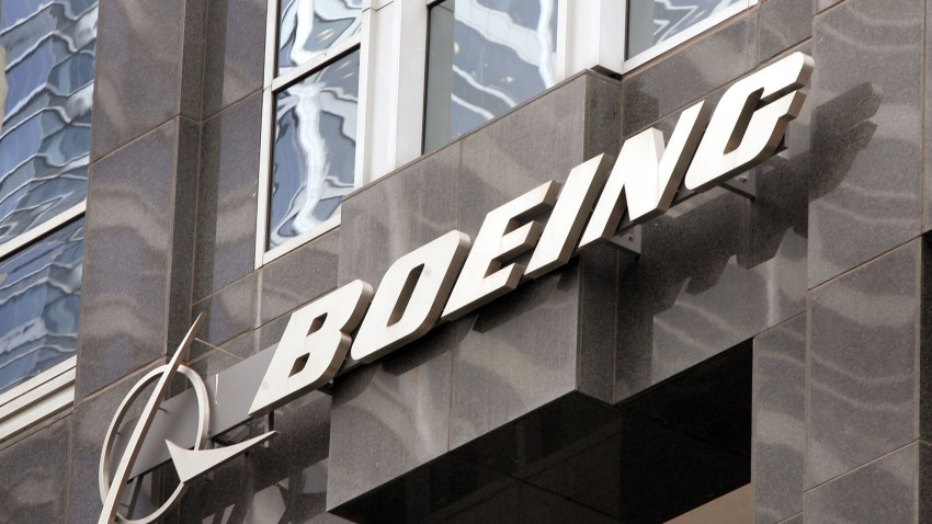 The Boeing logo hangs on the corporate world headquarters