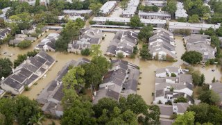 High view of flooded apartment buildings after Hurricane Harvey.