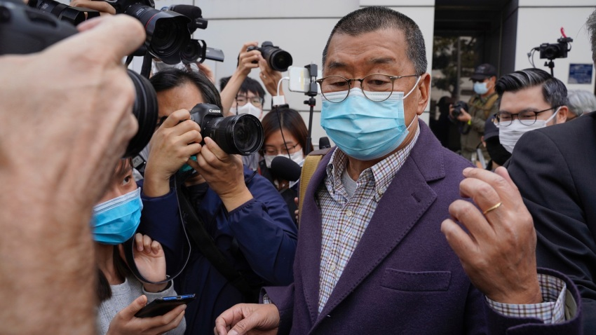 Founder of Hong Kong's Apple Daily newspaper, Jimmy Lai, walks out from a police station after being bailed out in Hong Kong, Friday, Feb. 28, 2020. Hong Kong's Apple Daily newspaper says the outspoken head of its publishing group, Lai, has been held by police over his participation in a protest march in August that was part of a months-long pro-democracy movement.