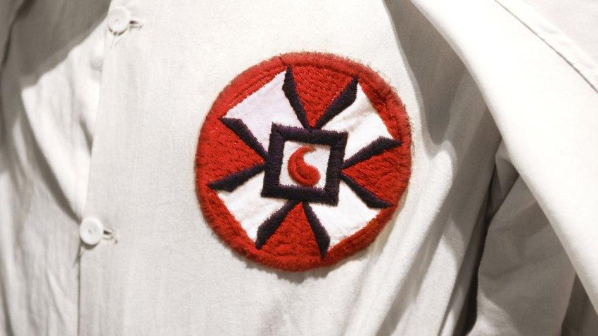 WHITE SUPREMACY RACIST KU KLUX KLAN MEMBER IN WHITE ROBE AND HOO