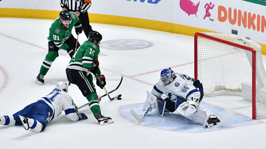 Jamie Benn #14 of the Dallas Stars slips in the game winning overtime goal against Andrei Vasilevskiy #88 of the Tampa Bay Lightning at the American Airlines Center on Jan. 27, 2020 in Dallas, Texas.
