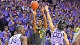 ared Butler #12 of the Baylor Bears hits a three-point shot against Mike McGuirl #00 of the Kansas State Wildcats during the first half at Bramlage Coliseum on Feb. 3, 2020 in Manhattan, Kansas.