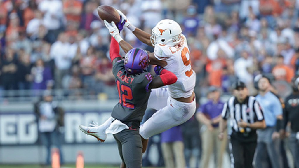 TCU Horned Frogs cornerback Jeff Gladney (#12) knocks the ball away from Texas Longhorns wide receiver Collin Johnson (#9) during the Big 12 conference college football game between the Texas Longhorns and TCU Horned Frogs at Amon G. Carter Stadium in Fort Worth, Texas.