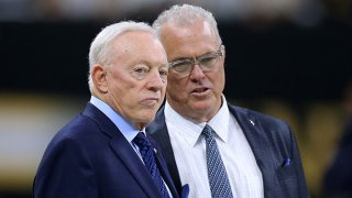 Owner Jerry Jones of the Dallas Cowboys and Executive Vice President Stephen Jones talk before a game against the New Orleans Saints at the Mercedes Benz Superdome on Sept. 29, 2019 in New Orleans, Louisiana.