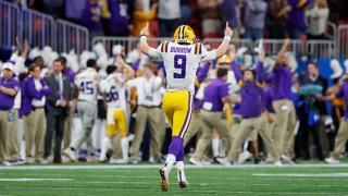 Quarterback Joe Burrow #9 of the LSU Tigers celebrates a touchdown in the third quarter over the Oklahoma Sooners during the Chick-fil-A Peach Bowl at Mercedes-Benz Stadium on Dec. 28, 2019 in Atlanta, Georgia.