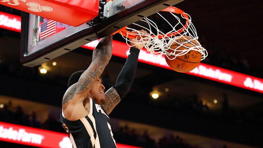John Collins #20 of the Atlanta Hawks dunks during the second half of an NBA game against the Dallas Mavericks at State Farm Arena on Feb. 22, 2020 in Atlanta, Georgia.