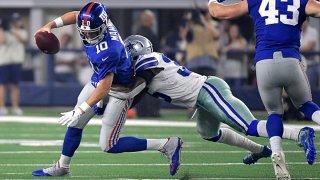 Dallas Cowboys defensive back Kavon Frazier (35) sacks New York Giants quarterback Eli Manning (10) during the second quarter on Sunday, Sept. 16, 2018 at AT&T Stadium in Arlington, Texas.