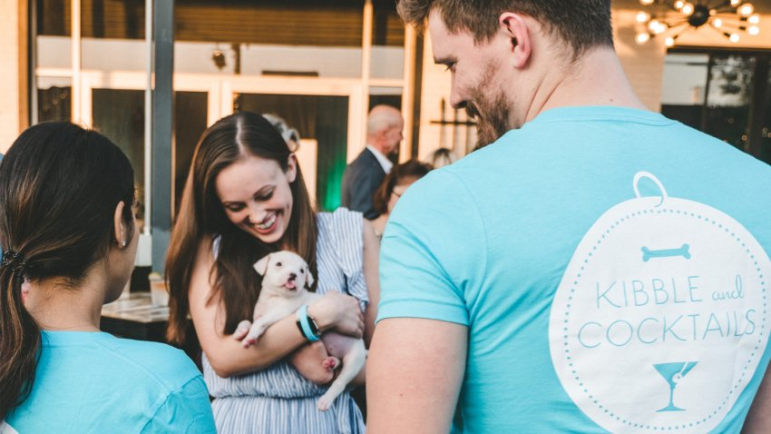 one man and two women one holds puppy