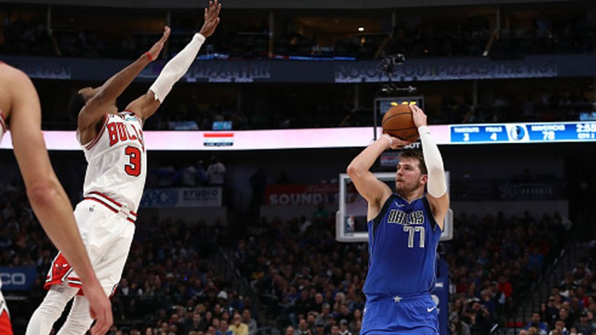 Luka Doncic #77 of the Dallas Mavericks makes a three-point shot against Shaquille Harrison #3 of the Chicago Bulls at American Airlines Center on Jan. 6, 2020 in Dallas, Texas.