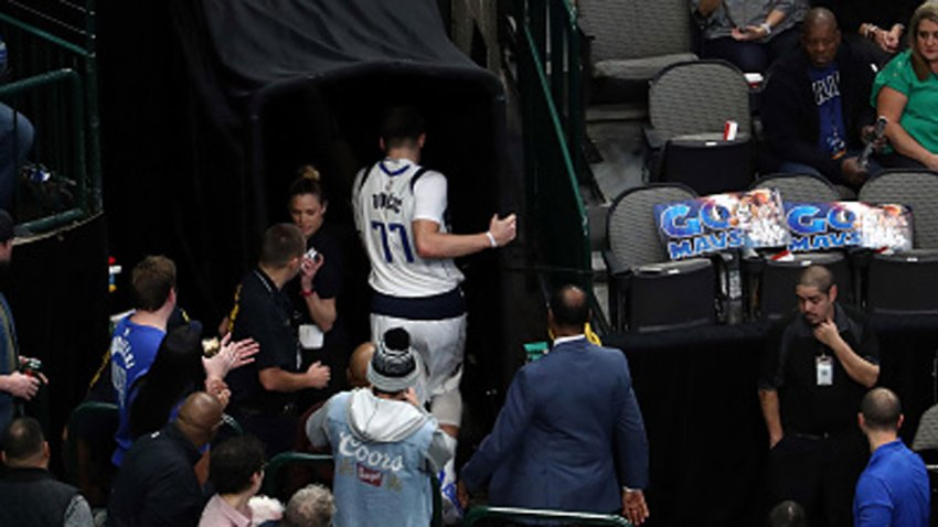 Luka Doncic #77 of the Dallas Mavericks leaves the game in the first half against the Miami Heat at American Airlines Center on Dec. 14, 2019 in Dallas, Texas.