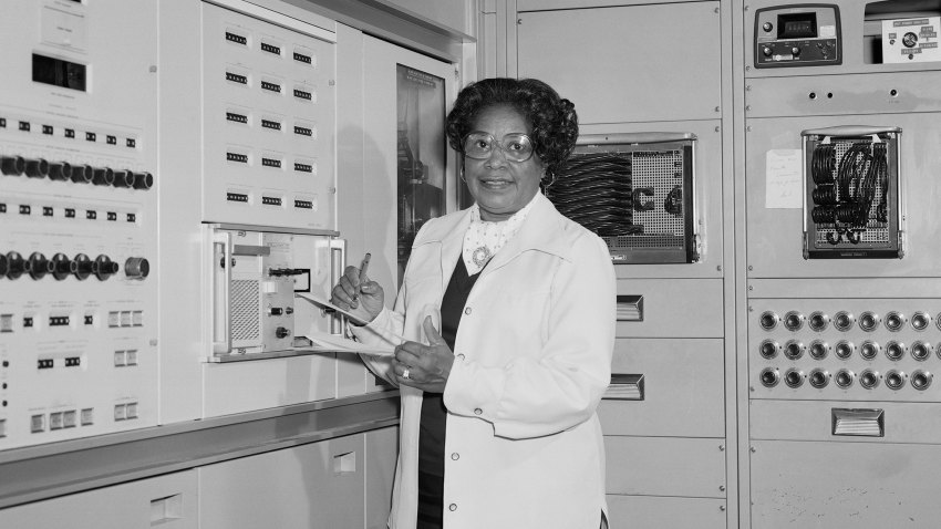 In this 1977 file photo, mathematician Mary Jackson, the first black woman engineer at NASA, poses for a photo at work at NASA Langley Research Center in Hampton, Virginia.