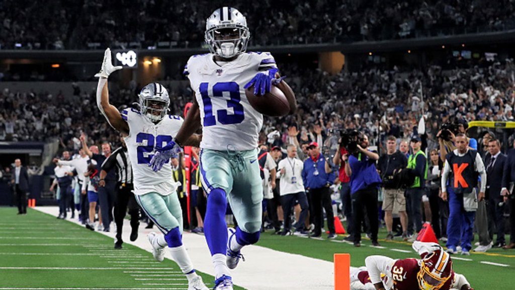 Michael Gallup #13 of the Dallas Cowboys scores a touchdown in the third quarter against the Washington Redskins in the game at AT&T Stadium on Dec. 29, 2019 in Arlington, Texas.