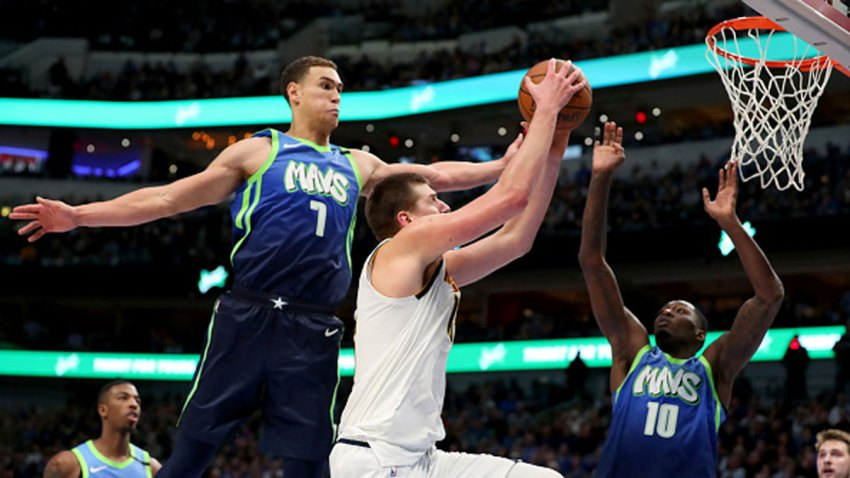 Nikola Jokic #15 of the Denver Nuggets drives to the basket against Dwight Powell #7 of the Dallas Mavericks in the second half at American Airlines Center on Jan. 8, 2020 in Dallas, Texas.