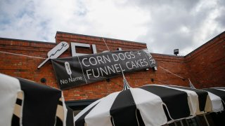 """A sign blocking out the name """"Fletch,"""" during an ongoing legal trademark battle, is seen at Corndog With No Name on Wednesday, Jan. 15, 2020 in Dallas. The new restaurant comes from the great-granddaughter of the man who brought Fletcher's corny dogs to the State Fair nearly 80 years ago."""
