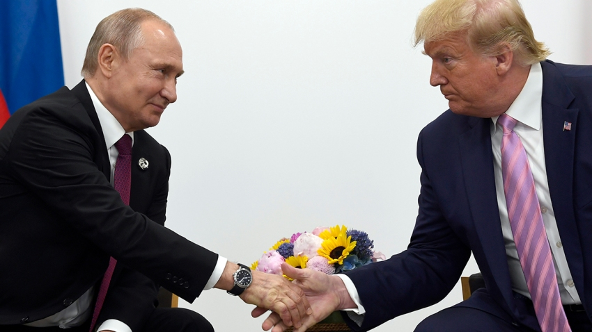 In this June 28, 2019, file photo, President Donald Trump shakes hands with Russian President Vladimir Putin during a bilateral meeting on the sidelines of the G-20 summit in Osaka, Japan.