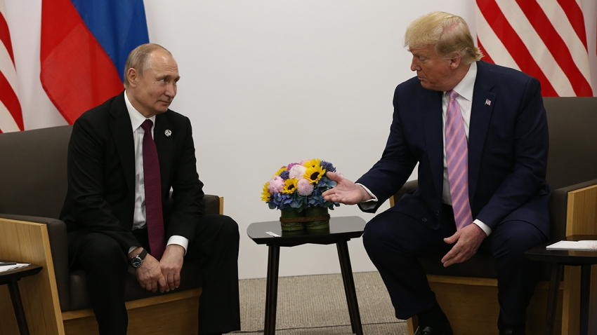 Russian President Vladimir Putin and U.S. President Donald Trump prepare to shake hands during a bilateral meeting at the G20 Summit, June 28, 2019, in Osaka, Japan.