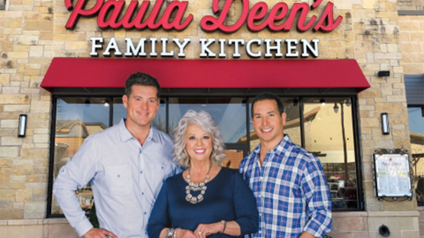 Paula Deen and sons in front of new restaurant in Fairview