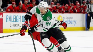 Roope Hintz #24 of the Dallas Stars skates with the puck during an NHL game against the Carolina Hurricanes at PNC Arena on Feb. 25, 2020 in Raleigh, North Carolina.