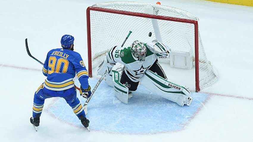 Ryan O'Reilly #90 of the St. Louis Blues scores the game winning goal in overtime against Anton Khudobin #35 of the Dallas Stars at Enterprise Center on Feb. 29, 2020 in St. Louis, Missouri.
