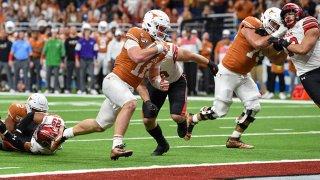 Texas Longhorns quarterback Sam Ehlinger (11) scores a third quarter rushing touchdown during the Alamo Bowl football game between the Utah Utes and Texas Longhorns at the Alamodome on Dec. 31, 2019 in San Antonio, Texas.
