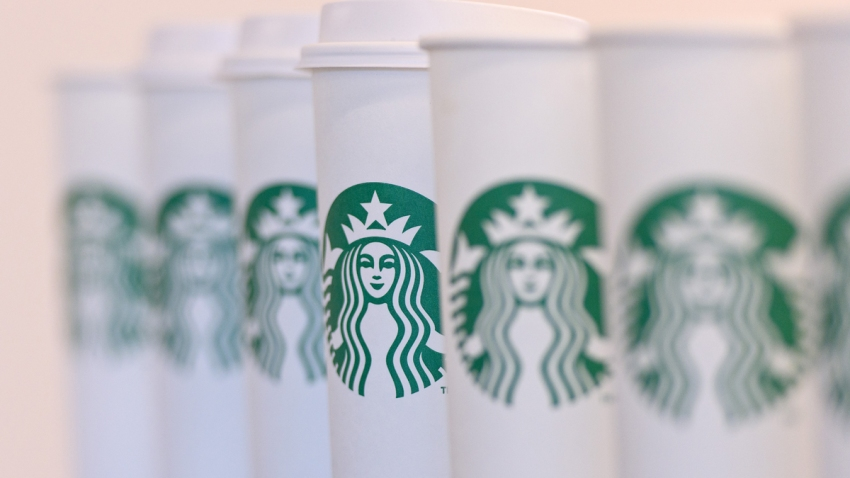 In this Feb. 18, 2016, file photo, a collection of venti sized Starbucks take away cups are seen in London, England.