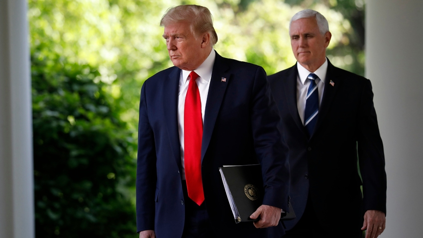 President Donald Trump and Vice President Mike Pence arrive to a news conference in the Rose Garden of the White House in Washington, D.C., April 27, 2020.