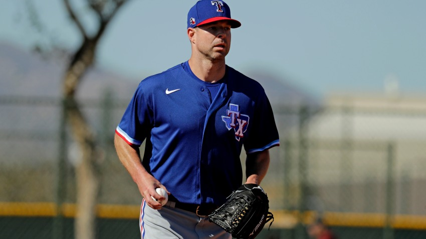 Texas Rangers pitcher Corey Kluber participates in a drill during spring training baseball practice Friday, Feb. 14, 2020, in Surprise, Arizona.