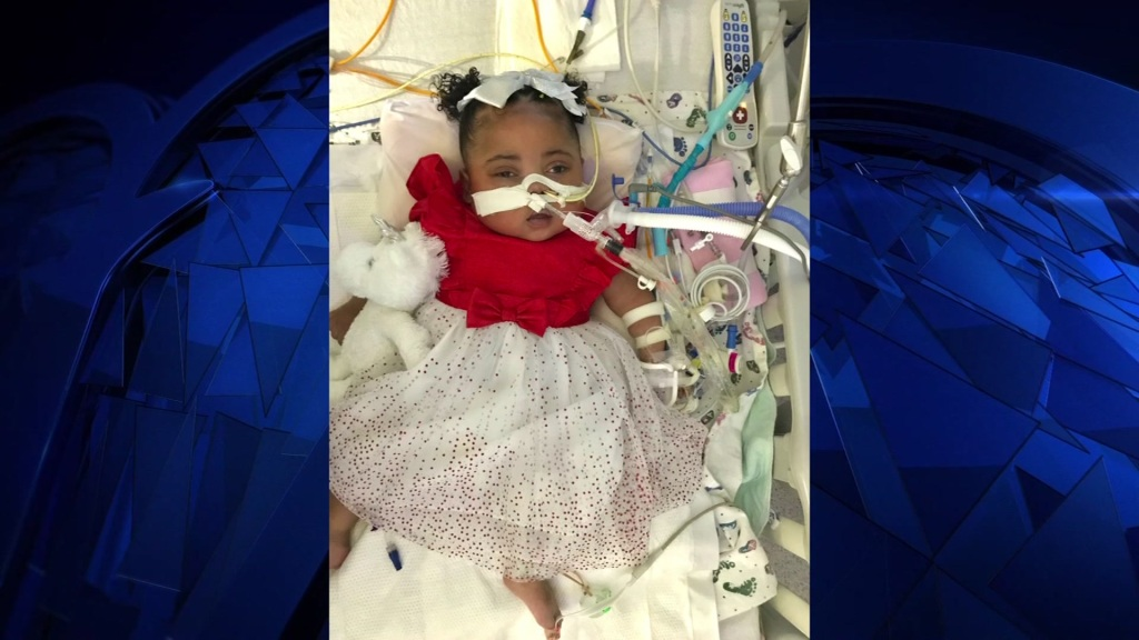Tinslee Lewis, dressed for Christmas above, has been at Cook Children's Medical Center in Fort Worth, Texas since her premature birth.