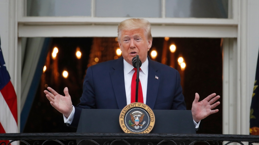"""In this May 22, 2020, file photo, President Donald Trump speaks during a """"Rolling to Remember Ceremony,"""" to honor the nation's veterans and POW/MIA, from the Blue Room Balcony of the White House in Washington."""