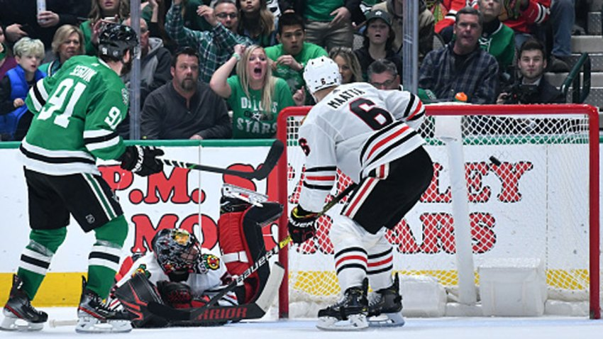 Tyler Seguin #91 of the Dallas Stars lifts a puck in for a goal in tight against Corey Crawford #50 of the Chicago Blackhawks at the American Airlines Center on Feb. 23, 2020 in Dallas, Texas.