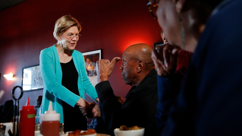 Democratic presidential candidate Sen. Elizabeth Warren, D-Mass., speaks with Bill Mamgum, center, and Shirley Mamgum at EllaEm's Soul Food, Thursday, Feb. 20, 2020, in North Las Vegas, Nev.