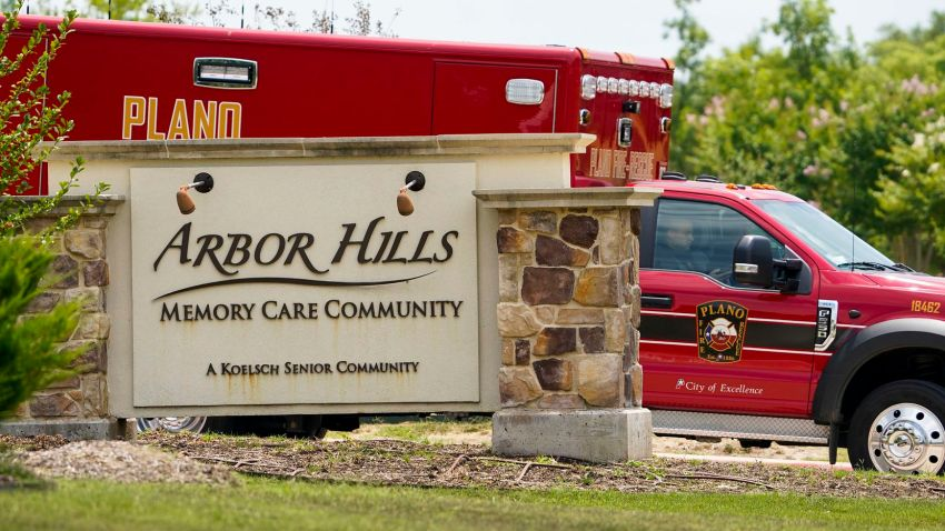 A Plano Fire-Rescue ambulance departs from Arbor Hills Memory Care Community in Plano on Monday. Plano Fire-Rescue officials were at the facility doing COVID-19 testing and discovered at least 17 patients who were symptomatic and needed hospitalization.