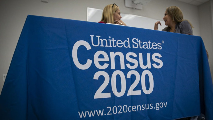 U.S. Census Bureau signage is displayed at a booth during a job fair for Hispanic professionals in Miami, Florida, U.S., on Wednesday, March 11, 2020. The Department of Labor is scheduled to release initial jobless claims figures on March 19.