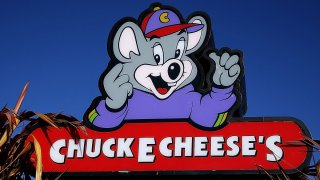 A sign is posted in front of a Chuck E. Cheese restaurant on January 16, 2014 in Newark, California.