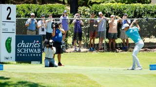 Jordan Spieth of the United States plays his shot from the second tee as fans look on from outside the fence during the third round of the Charles Schwab Challenge on June 13, 2020 at Colonial Country Club in Fort Worth, Texas.