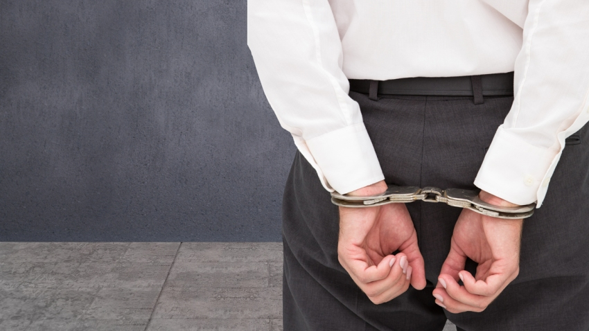 crime-stock-white-collar-handcuffs-professional-businessman