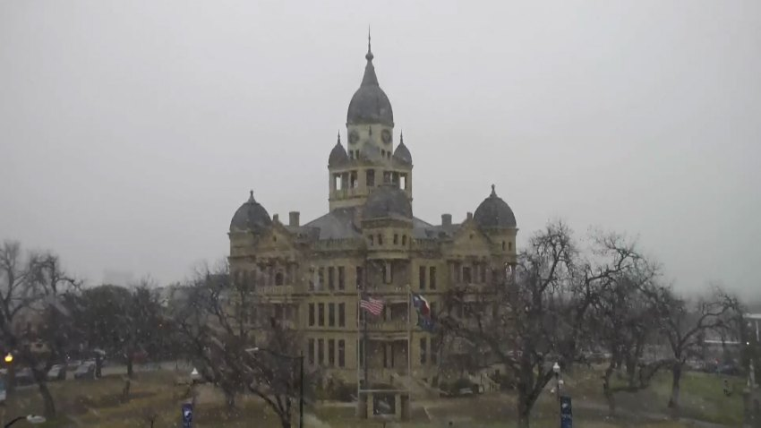 snow flurries at the denton county courthouse