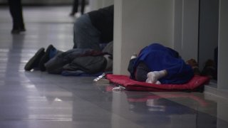 On recent cold nights, dozens of homeless people have been camping out in Terminal A, close to a DART station connecting the airport to Dallas.