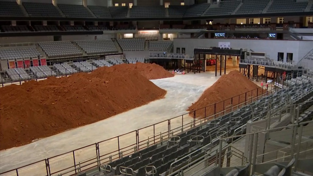 Crews started the daunting task of removing the 16 million pounds of dirt that covered the rodeo floor and the backstage area of Dickies Arena.