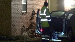 A woman is in custody Thursday morning after crashing her car into a Fort Worth home and trying to run away, police say.