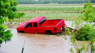 IRVING FIRE RESCUES TRUCK IN SWIFT WATER