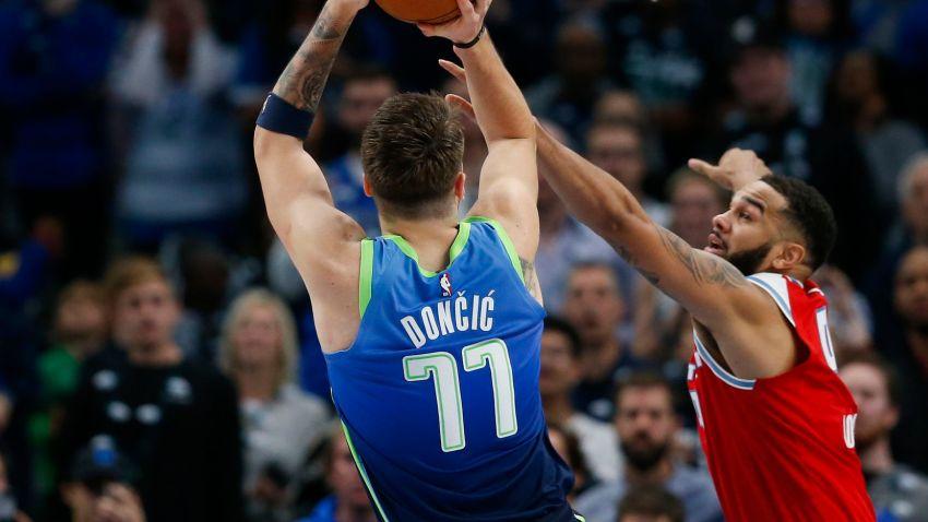 Sacramento Kings guard Cory Joseph (9) guards Dallas Mavericks forward Luka Doncic (77) during the second half of a NBA matchup between the Dallas Mavericks and the Sacramento Kings on Sunday, Dec. 8, 2019 at American Airlines Center in Dallas.