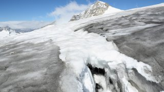 Icicles hang in a crevasse on the upper section of the Outer Mullwitzkees glacier on September 8, 2016 near Hinterbichl, Austria. A team from the Austrian Institute for Interdisciplinary Mountain Research has been conducting annual measurements as part of a study begun in 2006 to asses the rate at which the glacier is shrinking in depth.