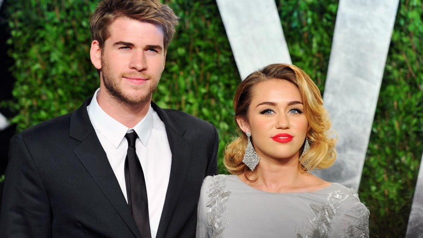 Actor Liam Hemsworth and actress/singer Miley Cyrus arrive at the 2012 Vanity Fair Oscar Party hosted by Graydon Carter at Sunset Tower on Feb. 26, 2012 in West Hollywood, California.